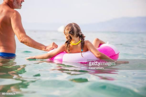 Little Girl Relaxing On Swimming Tube