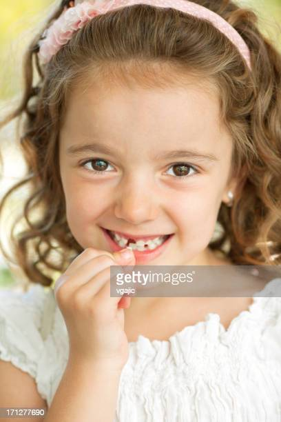 Little Girl Removing Tooth