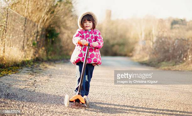 Little girl riding scooty