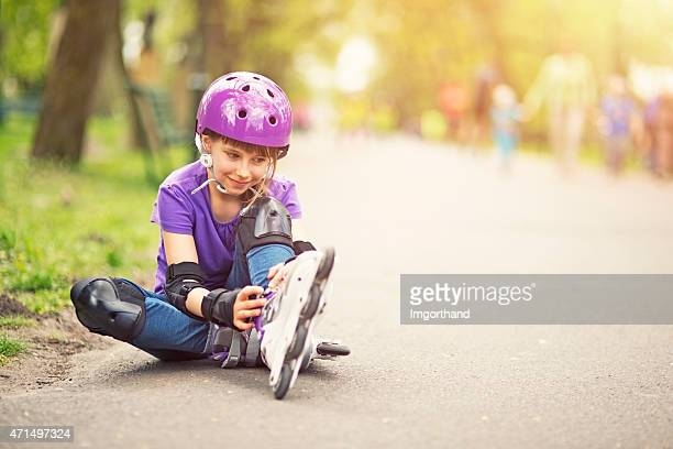 Little girl rollerskating in park