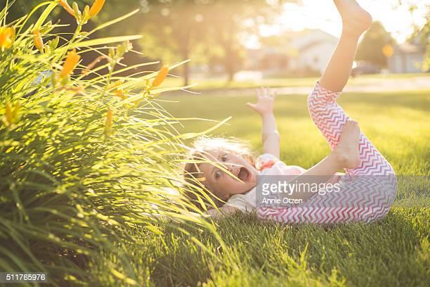 Little Girl Rolling in Grass