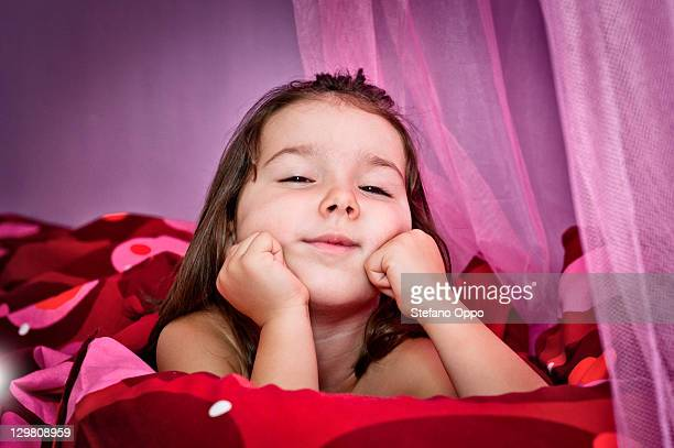 Little girl serious on bed
