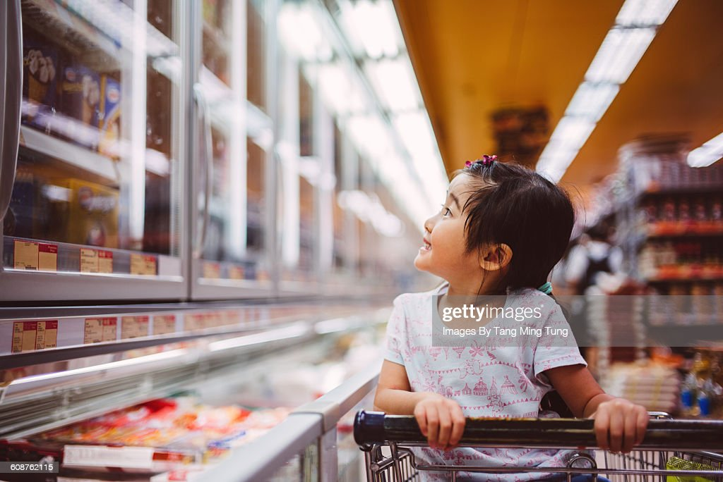 Little girl shopping at supermarket