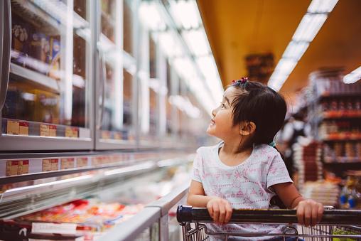 Little girl shopping at supermarket
