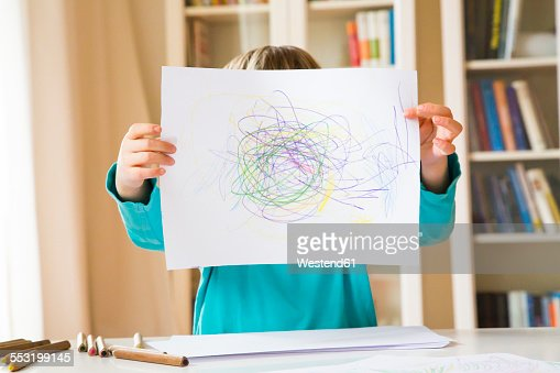 Little girl showing drawing