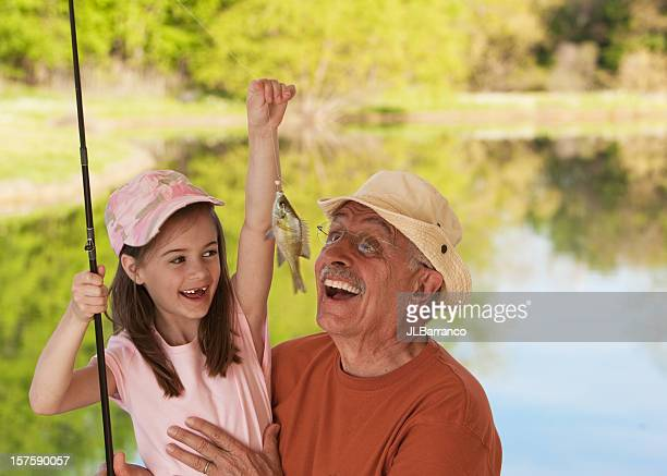 Little Girl Showing Fish to Grandfather