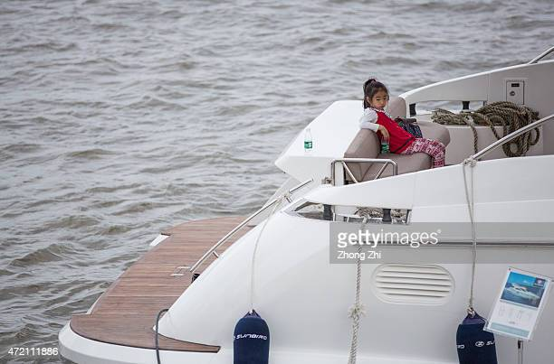 A little girl sits on the yacht during the Luxury Boat Show at Asian Games City on May 2 2015 in Guangzhou China As the number of Chinese middle...