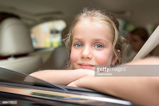 Little girl sitting in a car