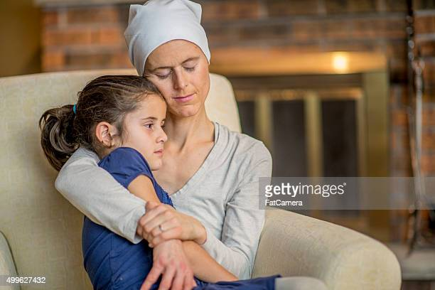 Little Girl Sitting in Her Mother's Lap