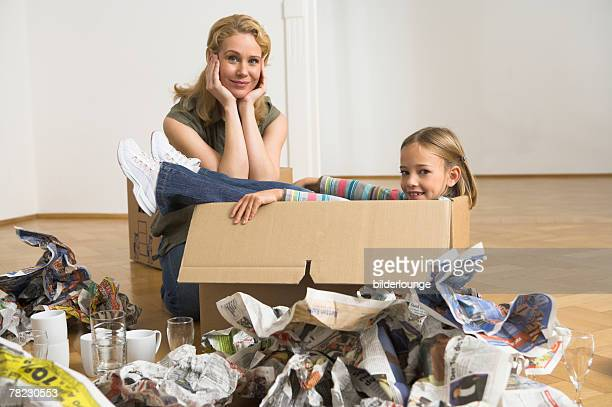 little girl sitting in moving box