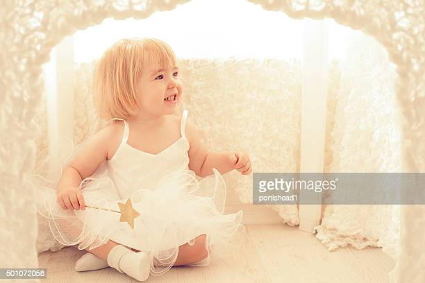 Little Girl Sitting In Playhouse
