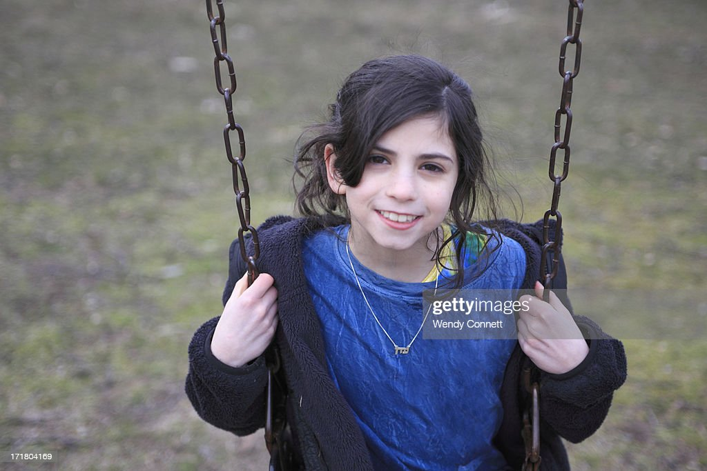 On girl swing sitting