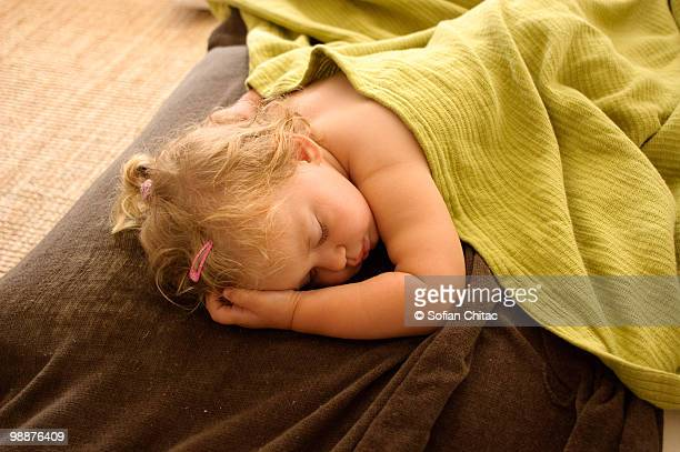Little girl sleeping on couch