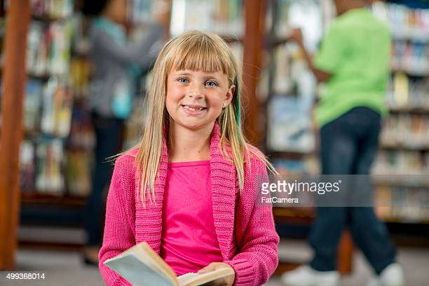 Little Girl Smiling at the Library