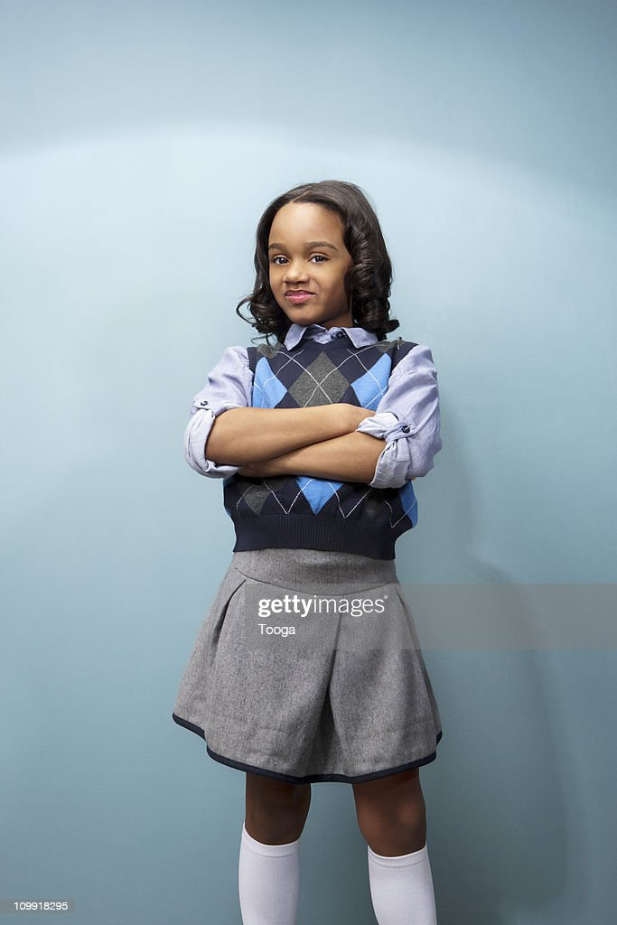Little girl smiling with arms crossed : Stock Photo
