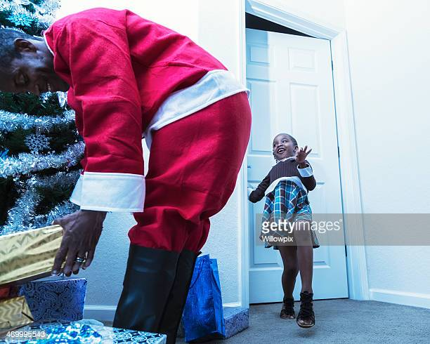 Little Girl Sneaking Behind Santa Claus