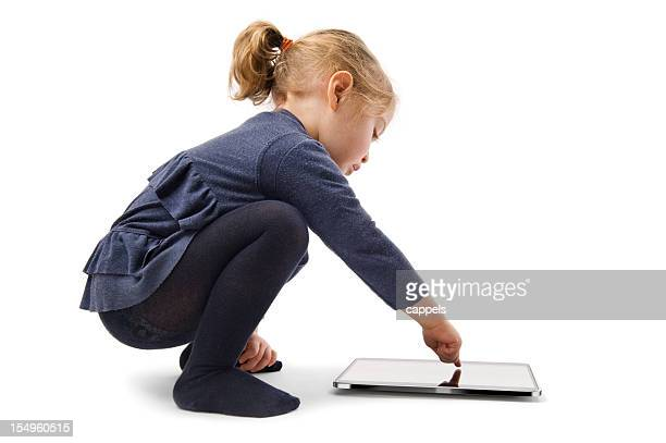 Little Girl Squatting With Tablet Computer.Color Image