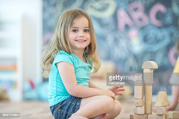 Little Girl Stacking Blocks