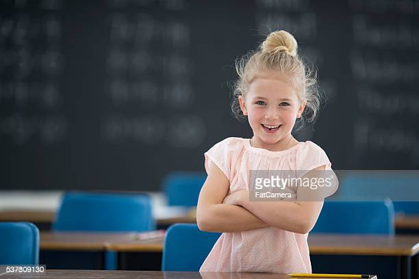Little Girl Standing in Her Classroom