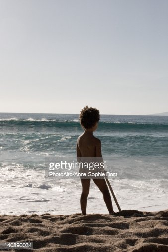 Little Girl Standing Naked At The Beach Rear View Stock