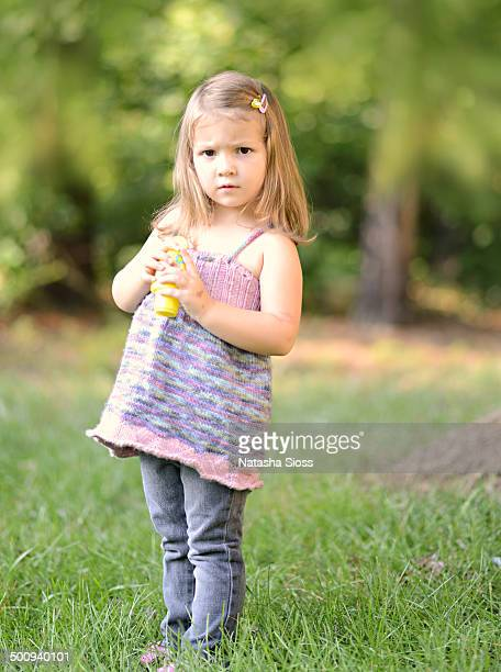 Little girl standing on the lawn