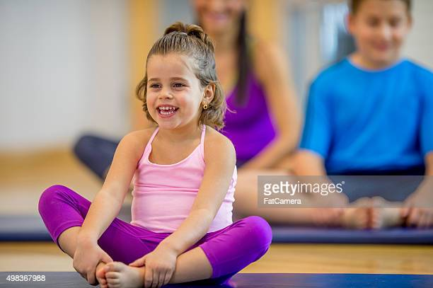 Little Girl Stretching with Her Family