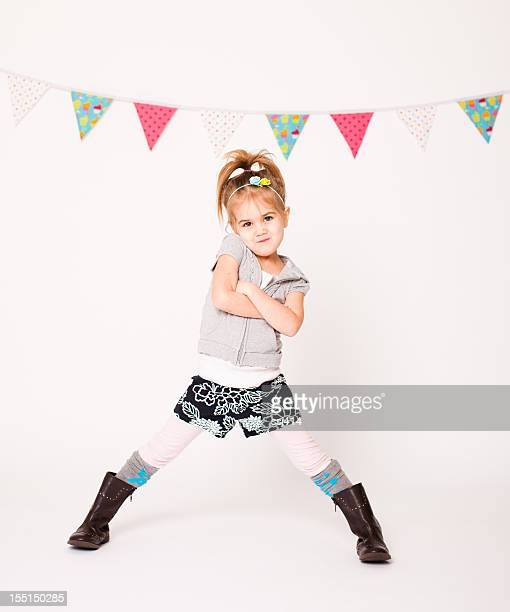 Little Girl Strikes a Pose on White Background
