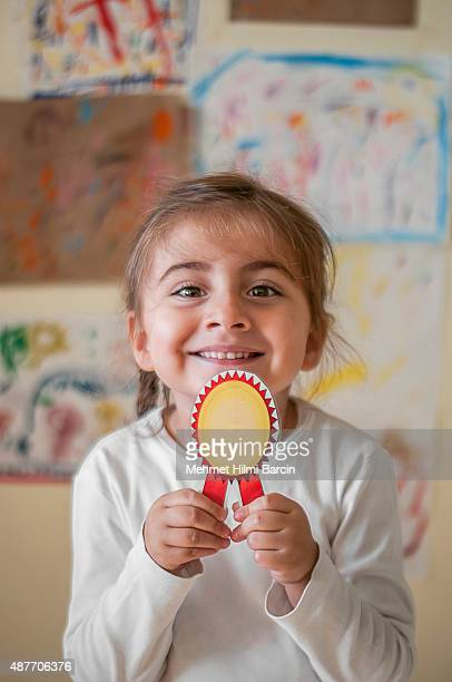 Little girl student with badge