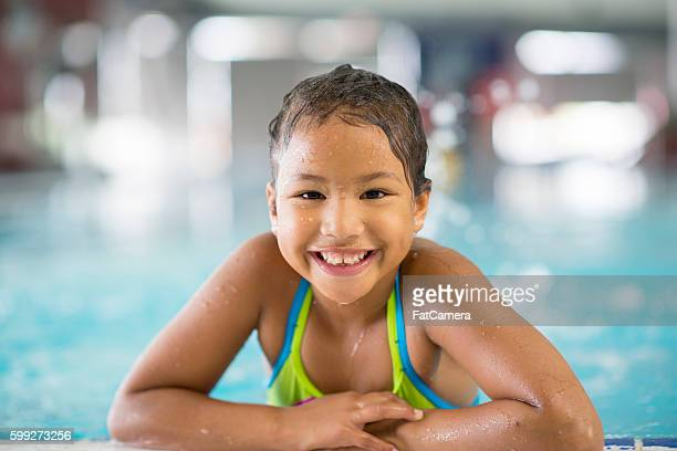 Little Girl Swimming at the Public Pool