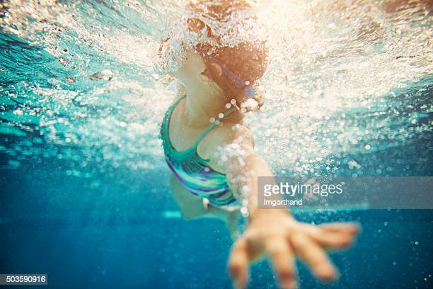 Little girl swimming crawl