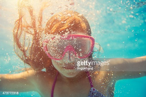 Little girl swimming underwater