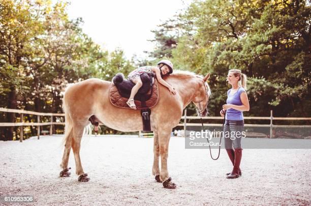 Little Girl Taking Horse-Riding Lessons