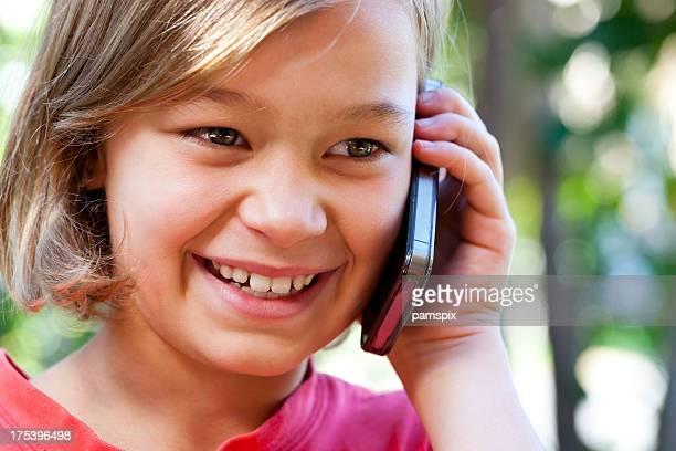 Little girl talking on mobile cell phone