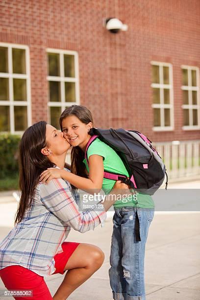 Little girl tells mom goodbye.  First day of school.