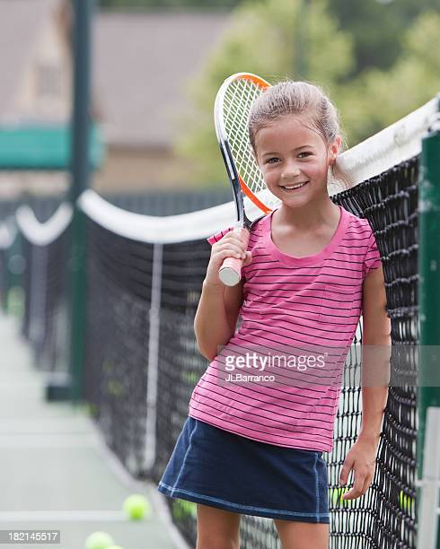 Little Girl Tennis Player Leaning on Net