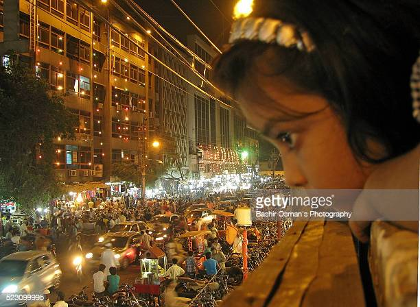 Little girl & the crowded market