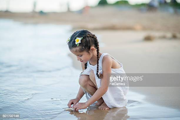 Little Girl Touching a Starfish