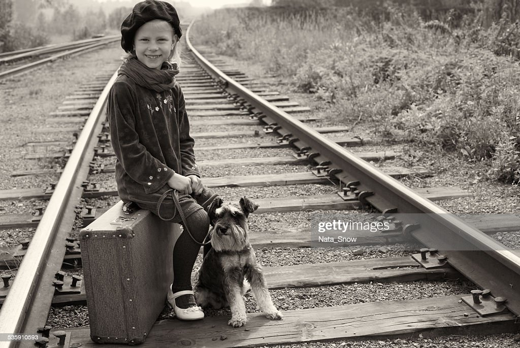Little girl traveling with her dog. The old European photo. : Stock Photo