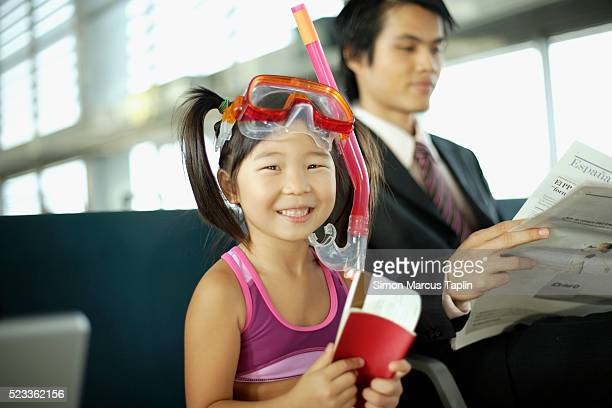 Little Girl Traveling with Her Parents