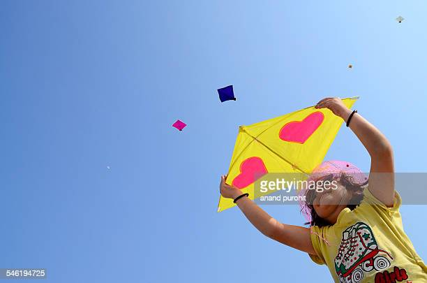 Little girl try to flying kite, India
