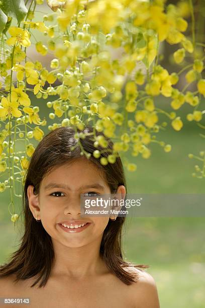 little girl under flowering tree