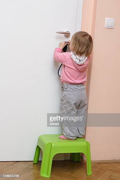 Little girl unlocking the door