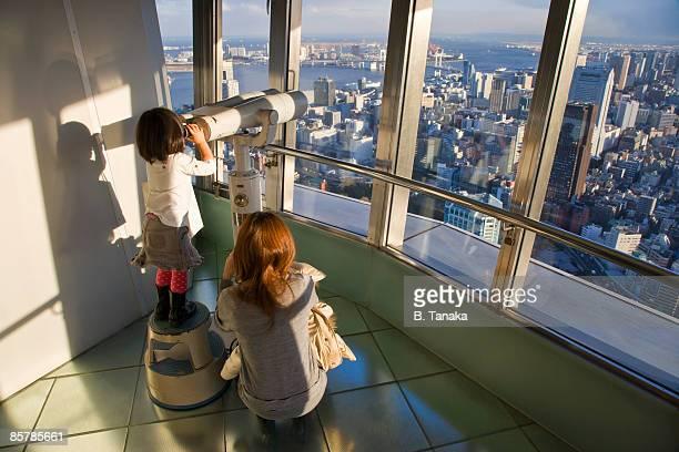 Little Girl Uses Big Binoculars at Tokyo Tower