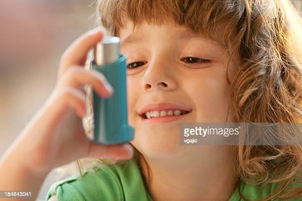 Little Girl using Asthma Inhaler Outdoor
