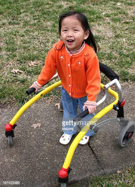 Little girl using walker
