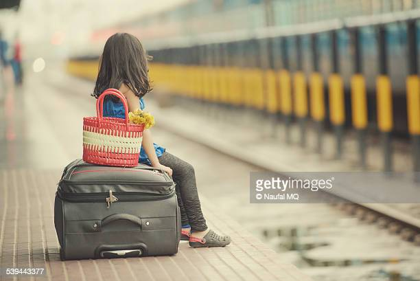 Little girl waiting in a railway station