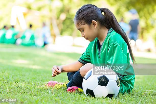 Little girl waits before soccer game