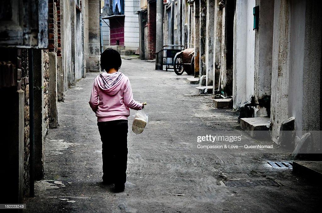 Little girl walking alone with her breakfast : Stock Photo