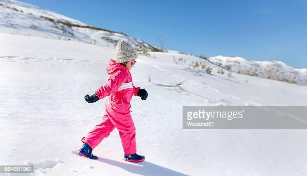 Little girl walking in snow