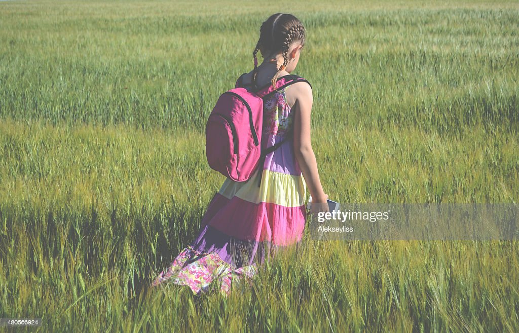 Little girl walking with gadget : Stock Photo
